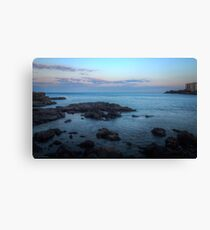 Rock and clouds at sunset Canvas Print