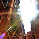 light flare through the buildings by xxnatbxx