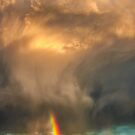 Storm Cloud Sprays a Rainbow by Gregory J Summers