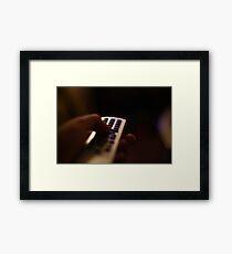remote Framed Print