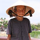 Lady on the Hoi An Bridge by mooksool