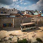 Abandoned bus in an empty backyard in Cienfuegos, Cuba. by jonathankemp