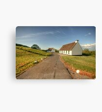 Thatched cottages Canvas Print