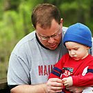 My son and grandson Sharing a Special Moment by Susan Blevins