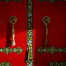 gompa - temple door. northern india. by tim buckley | bodhiimages