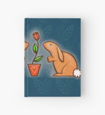 Two Bunnies in blue background Hardcover Journal