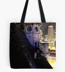 A caped crusader watches over gotham Tote Bag