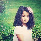 a flower in her hair by Angel Warda