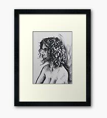 Young girls face Framed Print
