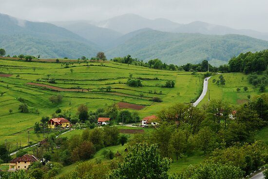 Village on the road, Romania by Antanas