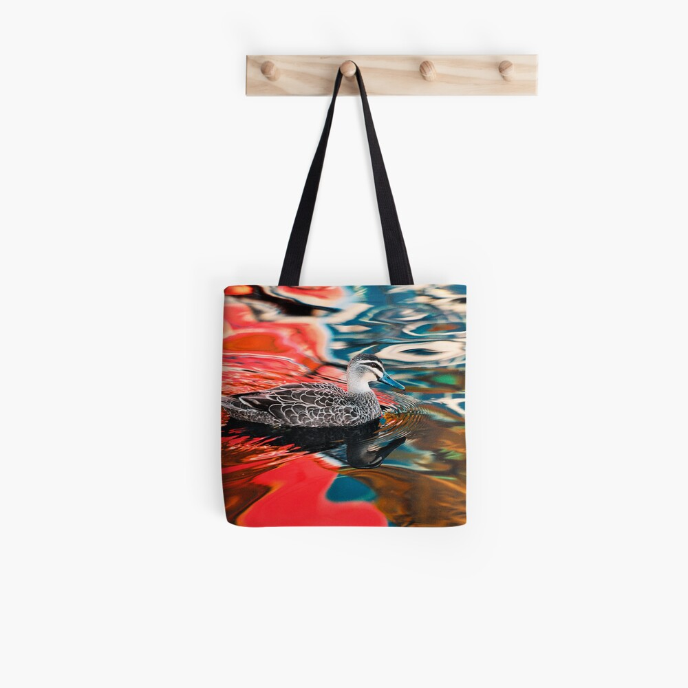 Duck in red water Tote Bag