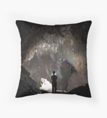 A lone caver looks up in wonder at white passage in G.B. Cave. Mendip hills. Throw Pillow