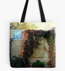 Plaques and baskets in a cottage garden Tote Bag