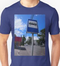 Road sign with a picture of a bus stop on a city street T-Shirt