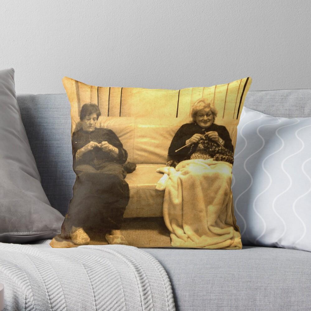 Two ladies knitting Throw Pillow