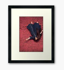 By the Flowers She was Swept Away Framed Print