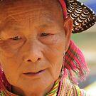 Flower Hmong woman by Judi Corrigan
