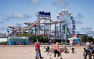 Skegness Fun Fair from the Beach by Ray Clarke