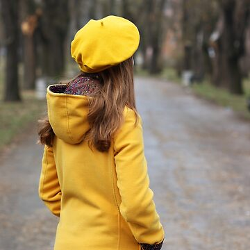 girl in a yellow coat and beret in park by goceris