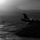 Silhouette of a surfer by Liza Yorkston