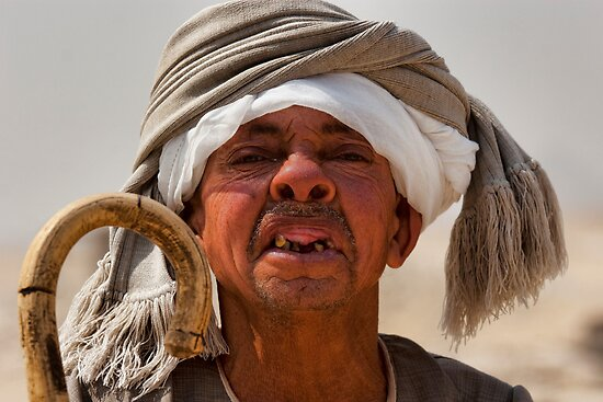 Toothless Egyptian midget man by InterfaceImages