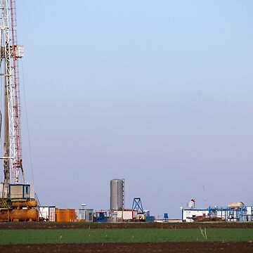 Oil and gas drilling rig and pump jack in oilfield mining industry by goceris