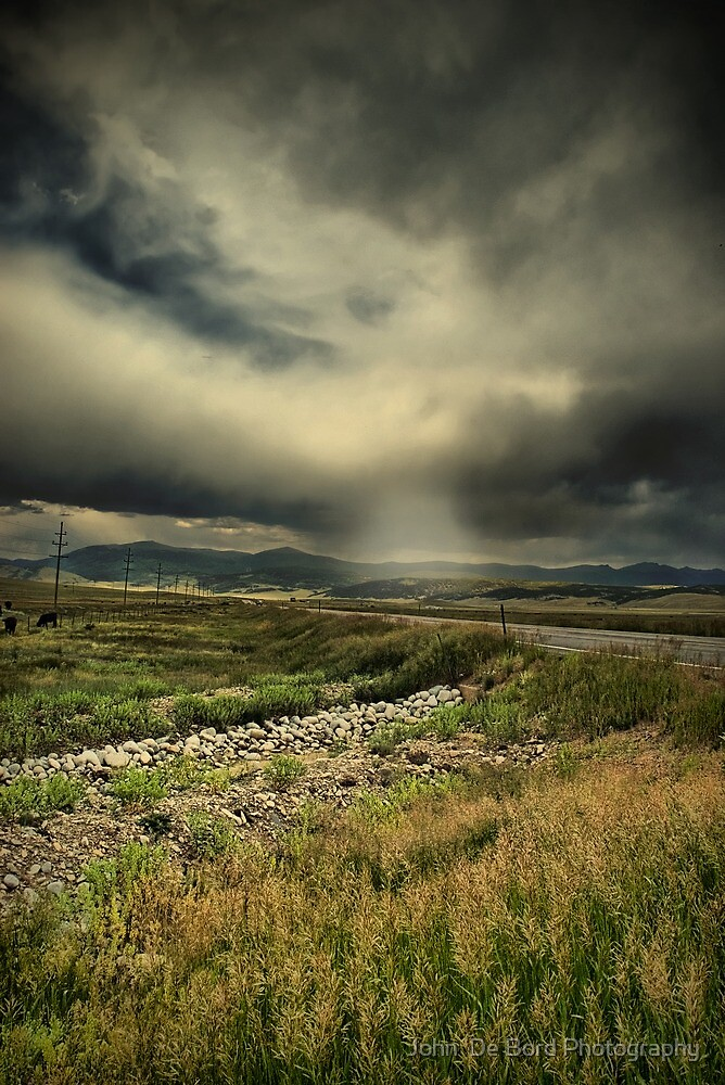 The Stormy Highway by John  De Bord Photography