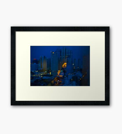 By the window Framed Print