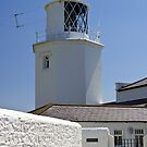Lighthouse and contrail by Steve plowman
