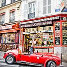 Red Vintage Race Car in Montmarte by John Englezos