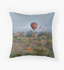 Ballons ride over temples of Bagan Throw Pillow