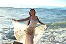 Ange Maya Wore White Floral Corset Skirt set Standing on Ocean like a Mermaid by ANGE MAYA