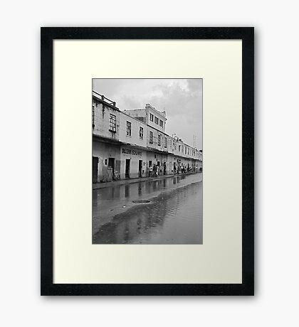 Mucha Lluvia en Mérida Framed Print