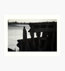 Remains of an old boat rotting away at low tide Art Print