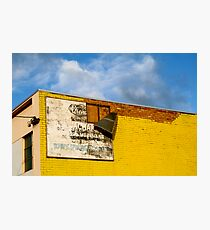 Shady Billboard on Yellow Wall Photographic Print
