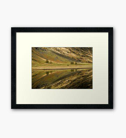 Reflecting on a Loch Framed Print
