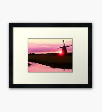 SUN AND WIND Framed Print