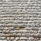 Close up view of a textured stone wall of a historical building by Sergey Orlov