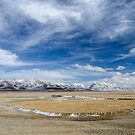High altitude Tibetan plateau and cloudy sky by Sergey Orlov