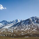 Beautiful snowy Tibetan mountain landscape with the lonely cloud by Sergey Orlov
