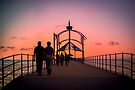 A Stroll Along Sunset Pier by Raymond Warren