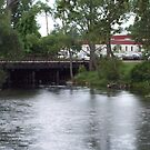 and old train Bridge in Grayling Michigan  by cdcantrell