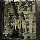 reflection in a marais window by dawne polis