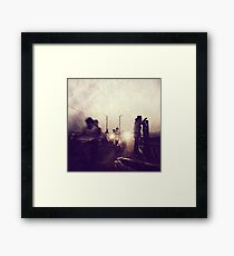 There are dark shadows on the earth, but its lights are stronger in the contrast. Framed Print