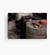 Old rusty fuel container Canvas Print