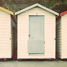 Yellow, Red and Blue Beach Huts by eyeshoot