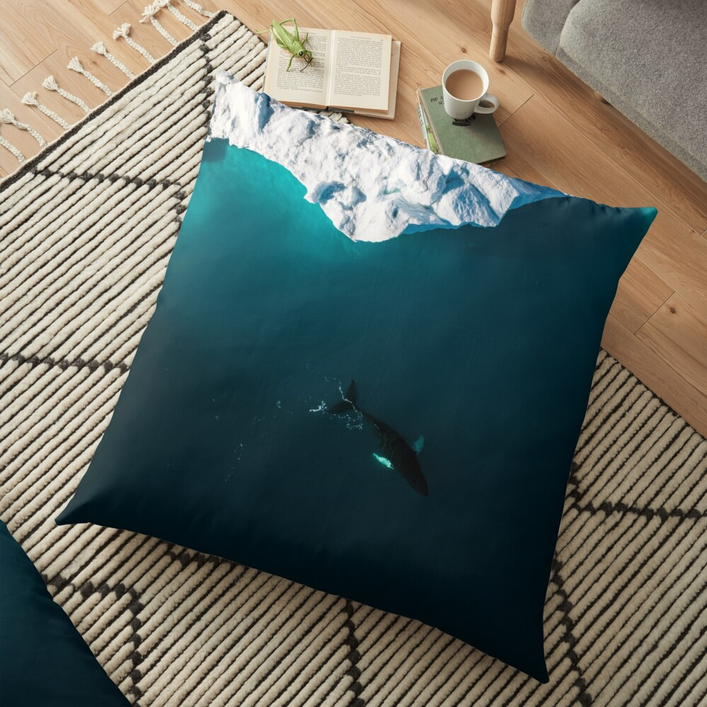 Aerial of a lone Humpback whale in front of an iceberg in Greenland Floor Pillow