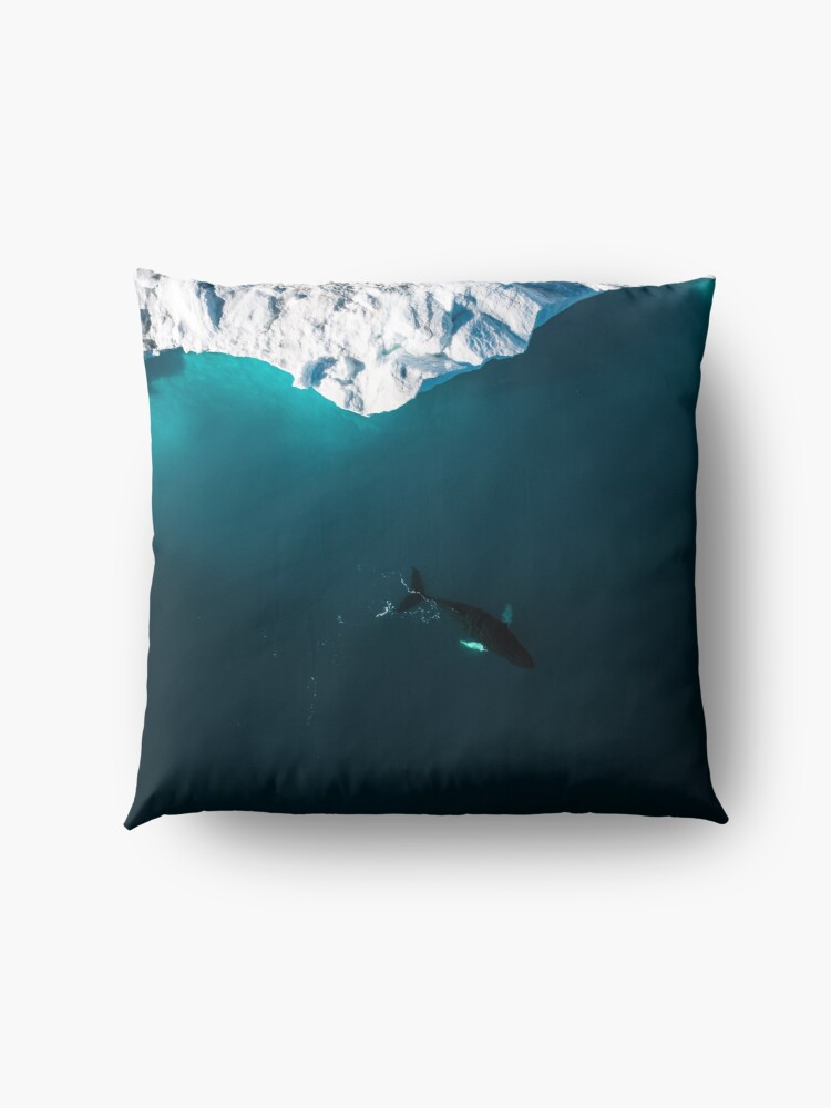 Alternate view of Aerial of a lone Humpback whale in front of an iceberg in Greenland Floor Pillow