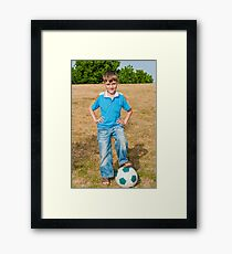 At the beginning of the soccer game Framed Print
