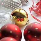 Red and gold Christmas balls on table linen by pogomcl